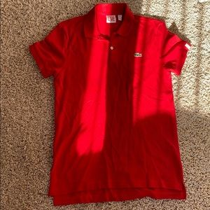 A Lacoste red formal shirt.